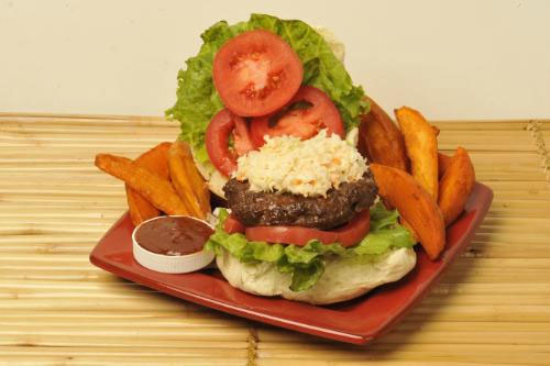 GOLDEN KRUST CARIBBEAN BAKERY & GRILL BURGER Jamaican Jerk Burger with Lime Coleslaw for summer entertaining with Island ease. (PRNewsFoto/Golden Krust Caribbean Bakery & Grill, Chas Orrico) NEW YORK, NY UNITED STATES