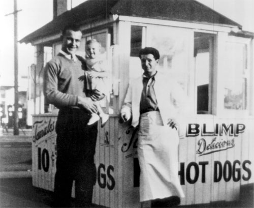 Founder Carl N. Karcher (left, with eldest daughter Anne) and one of his first employees in an undated photo from the early 1940s