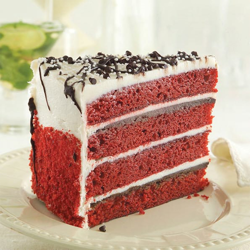 Brilliant red velvet cake layers, stacked four high, are spread with deep chocolate truffle filling, then filled and frosted with tangy cream cheese icing. This luscious dessert is baked from scratch and then frozen for perfection. You will always serve something exceptional when you offer Sweet Street Desserts.