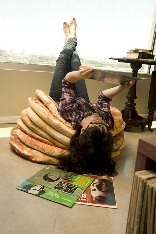 Relaxing with the Pancake Floor Pillows by Todd von Bastiaans.